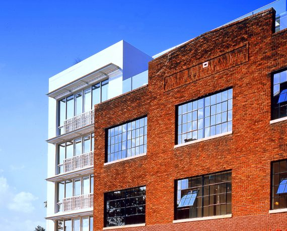 Brick exterior of Rainbow Lofts in sunlight